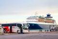 Irizar i6 near the cruise ship Royalty Free Stock Photo
