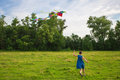 Irl running with colorful kite Royalty Free Stock Photo