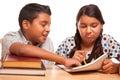 Irmão e irmã latino americanos having fun studying Imagens de Stock