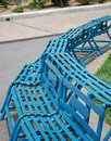 Iron benches painted with skyblue paint Royalty Free Stock Photo
