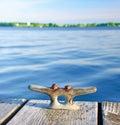 Iron bollard on wooden pier Royalty Free Stock Photography