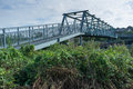Iron bridge an spanning a river Royalty Free Stock Image