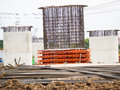 Iron construction to construct concrete pole on working site Royalty Free Stock Images