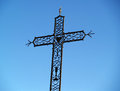 An iron cross against a blue sky, Chusclan, France Royalty Free Stock Photography