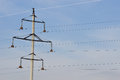 Iron electric pole in the sky high concrete column with wires against Royalty Free Stock Photos