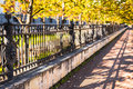 Iron fence with face in garden castle of saint petersburg russia Stock Photo