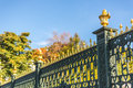Iron fence in garden with face castle of saint petersburg russia Royalty Free Stock Images