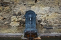 Iron fountain in a village Royalty Free Stock Photo