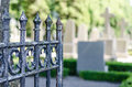 Iron gate in the a graveyard Stock Photo