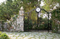 Iron gate in stone wall the park Royalty Free Stock Photos