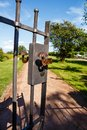 Iron gate to a rural park Royalty Free Stock Photo