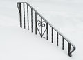 Iron heart buried in snow wrought railing with decoration Royalty Free Stock Images