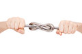 Iron knot in male hands sturdy of rod closeup Stock Photography