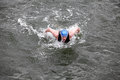 Iron man swimmer in cap and wetsuit breathing performing butterfly stroke Royalty Free Stock Photo