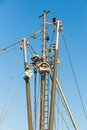 Iron mast with rigging of a fishing ship and blue sky Royalty Free Stock Photography