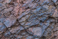 Iron ore texture closeup - natural minerals in the mine. Stone texture of open pit. Extraction of minerals for heavy Royalty Free Stock Photo