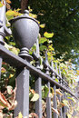 Iron railings bordering a london garden square in autumn park Stock Image