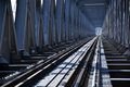 Iron railway bridge rails. perspective view Royalty Free Stock Photo