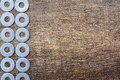 Iron ring the composition of the on the side of the wood texture background Royalty Free Stock Photos