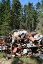 Iron scrap polution forest Royalty Free Stock Photo