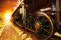 Iron wheels of stream engine locomotive train on railways track perspective to golden light forward use for old and classic period Stock Images