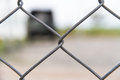 Iron wire fence on blurred background Stock Photos