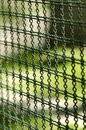Iron wire fence a green old Royalty Free Stock Photos
