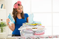 Ironing depressed young housewife with basket laundry for Royalty Free Stock Image