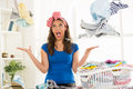 Ironing depressed young housewife with basket laundry for Stock Images