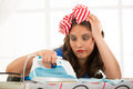 Ironing depressed young housewife clothes Stock Photo