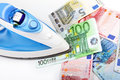 Ironing euro money banknotes on white Stock Photography