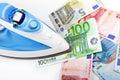 Ironing euro money banknotes on white Stock Photography