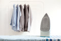 Ironing housework ironed folded shirts clean concept still life garment apparel cloth indoors Royalty Free Stock Images