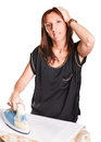 Ironing woman a tired of her clothes Royalty Free Stock Image
