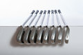 Irons are ready for inspection golf lined up in an organized row Stock Photography