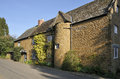 Ironstone houses cotswold in hook norton oxfordshire Stock Photography