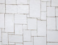 Irregular white tiles on a wall Royalty Free Stock Photography