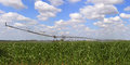 Irrigation system for agriculture an in a grain field Stock Photo