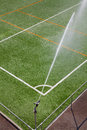 Irrigation system machine working on a football green field Stock Photo