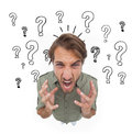 Irritated man gesturing and yelling with question marks on the background Royalty Free Stock Photos