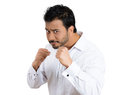 Irritated young man raising fists in the air looking at the camera as if to knock down someone closeup portrait of hostile angry Royalty Free Stock Photos