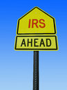 Irs ahead post sign conceptual road over sky Stock Image
