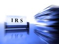 Irs card with tax files on desck zoomed showing progress or action Royalty Free Stock Image