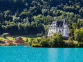 Iseltwald castle, view from alpine lake Brienz Royalty Free Stock Photo