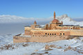 Ishak pasha palace in winter seson castle against white mountains and blue sky background the is located the dogubeyazit district Stock Photo