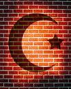 Islam sign on a red brick background Stock Photo