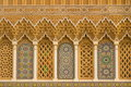 Islamic calligraphy and colorful geometric patterns a Morocco. Royalty Free Stock Photo