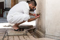 Islamic religious rite ceremony of ablution hand washing muslim man preparing to take in mosque Stock Image