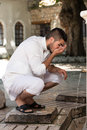 Islamic religious rite ceremony of ablution mouth washing muslim man preparing to take in mosque Royalty Free Stock Photography