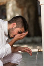 Islamic religious rite ceremony of ablution nose washing muslim man preparing to take in mosque Royalty Free Stock Photography